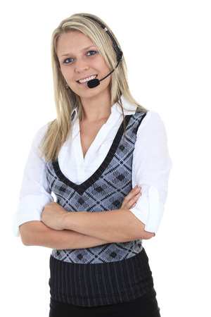 contact center: Beautiful blond business woman with headset. Stock Photo