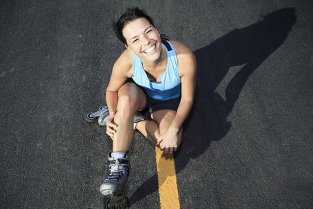 rollerblade: A woman with is rollerblade in summer time