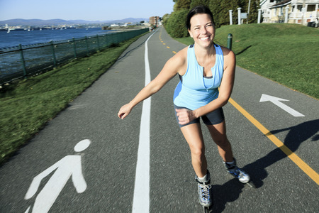 blading: A woman with is rollerblade in summer time