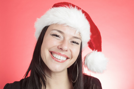 A christmas woman with a Christmas hat.