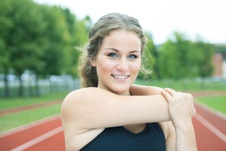 outdoor shot: A Runner woman jogging on a field outdoor shot Stock Photo