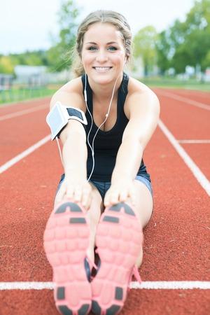 A Runner woman jogging on a field outdoor shot Stock Photo