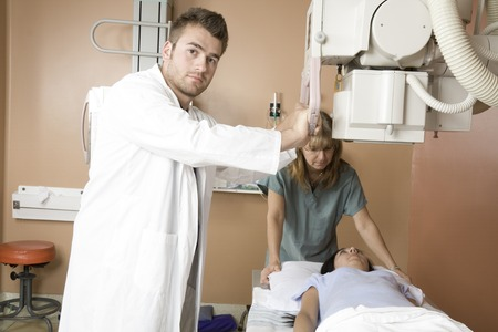 x ray equipment: A Patient with doctor radiologist in a hospital Stock Photo