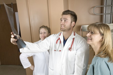 hospital patient: A Patient with doctor radiologist in a hospital Stock Photo