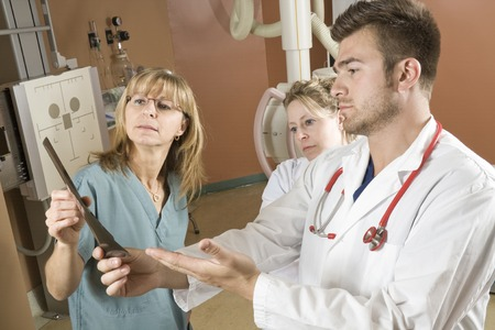 x ray machine: A Patient with doctor radiologist in a hospital Stock Photo