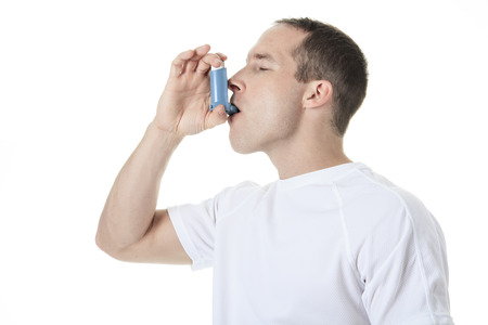 asthma: A sport man using a asthma pump Stock Photo