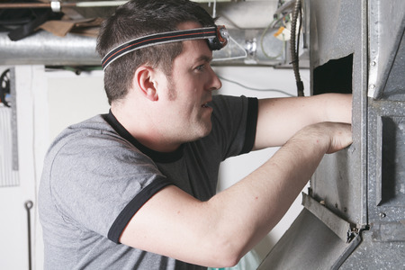 furnace: A ventilation cleaner man at work with tool