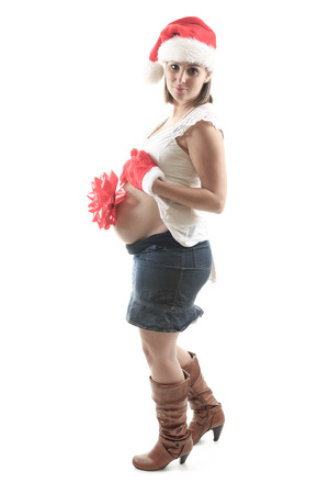 25 29: Young pregnant woman against white background