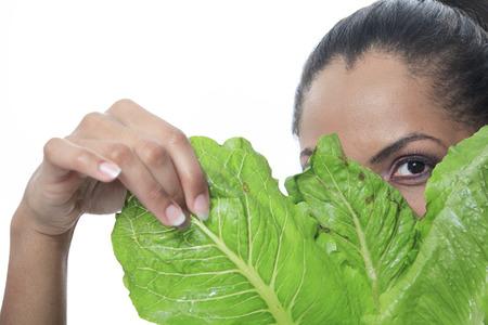 mulatto: A mulatto person look through a salad