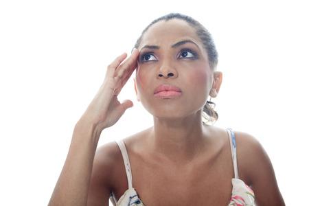 mulatto: A mulatto person having a concentration problem. Stock Photo