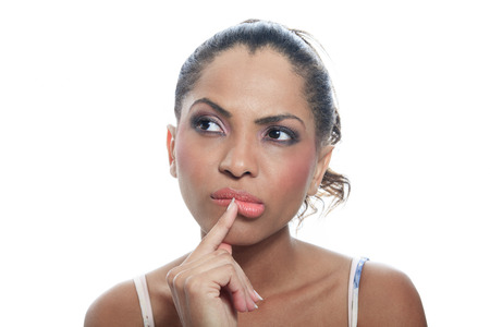thinking woman: A mulatto person having a thinking situation Stock Photo