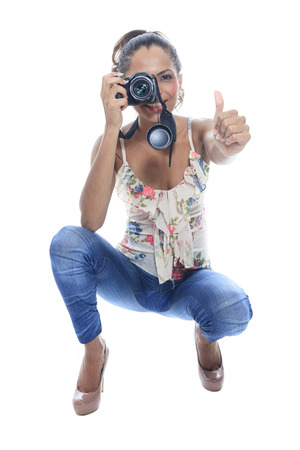 snaps: Girl-photographer takes snaps, isolated on white Stock Photo