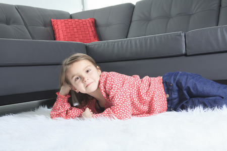 8 years old: A 8 years old child laying down at home alone Stock Photo
