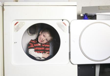 dryer: A kid on the dryer having fun