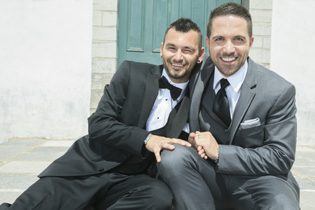 outdoor wedding: Portrait of a loving gay male couple on their wedding day. Stock Photo