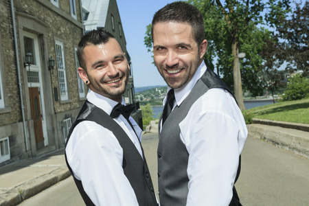 homosexual couple: Portrait of a loving gay male couple on their wedding day. Stock Photo