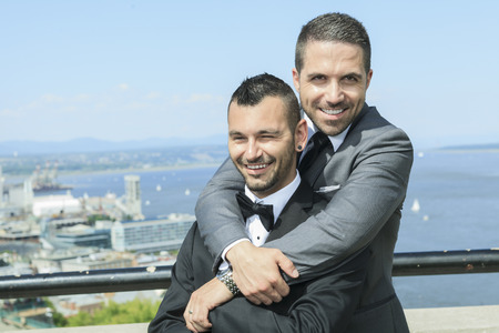 Portrait of a loving gay male couple on their wedding day. Stock Photo