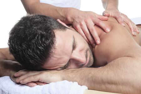 Man receiving Shiatsu massage from a professional masseur at spa salon