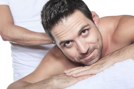 salon and spa: Man receiving Shiatsu massage from a professional masseur at spa salon