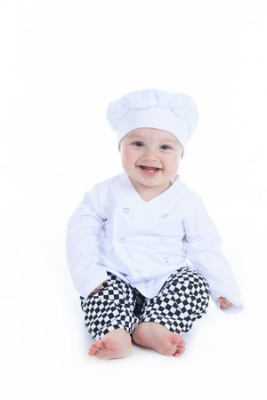 Cute little cook boy in front of a white background photo