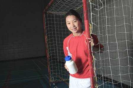 A female soccer player in a stadium Banque d'images