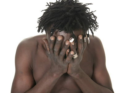 psycho social: A sad african over a white background Stock Photo