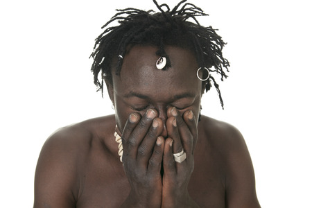 A sad african over a white background Stock Photo