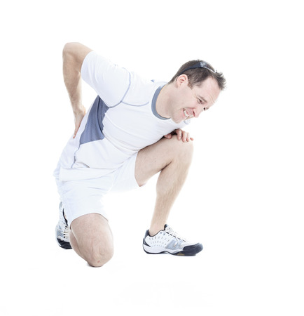 back ache: A sport men who have a back injury. Stock Photo