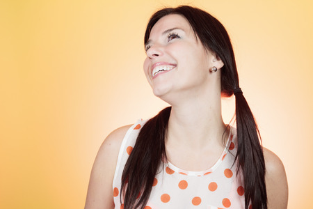 shoulder buttons: A woman in front of a color background. Stock Photo