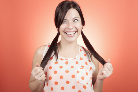 shoulder buttons: A woman in front of an orange background.