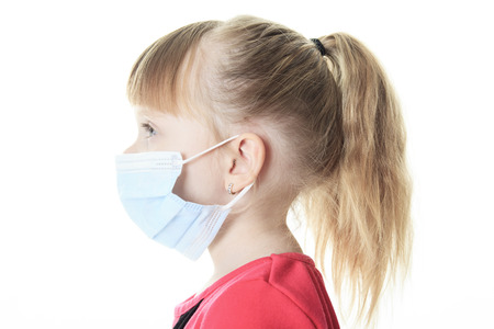 protective: A Little girl with the protective mask Stock Photo