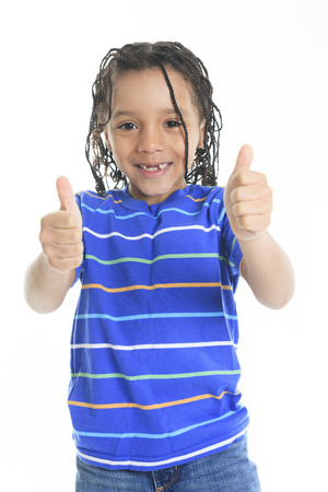 A thumb up african boy in front of a white background.