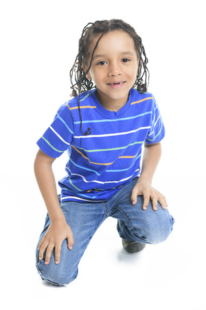 A african boy in front of a white background. 新聞圖片