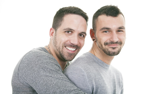 20 24 years old: A homosexual couple over a white on studio