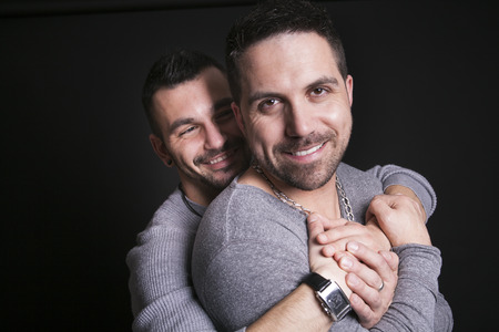 gay couple: A gay couple on black studio