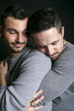 gay couple: A gay couple on black studio