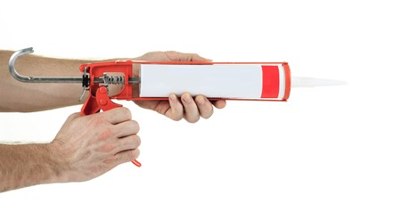rubber sealant: caulking gun  in front of a white background