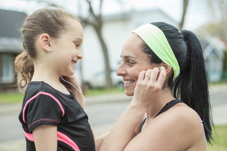 earphone: A Close-up portrait mother daughter earphone