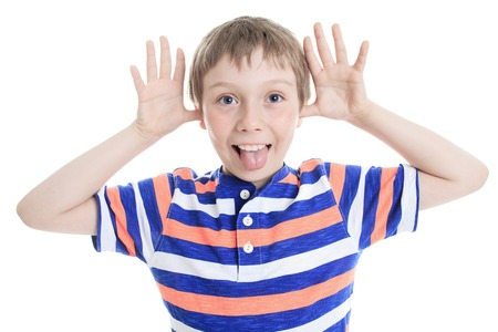 wincing: A Little boy wincing on white background Stock Photo