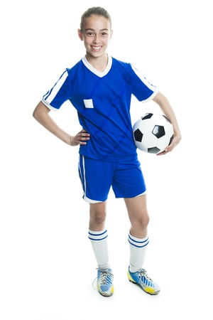 A girl in sport wear with football isolated on white background Stockfoto