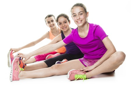 girls youth: Some running young girl in sport cothes, white background Stock Photo