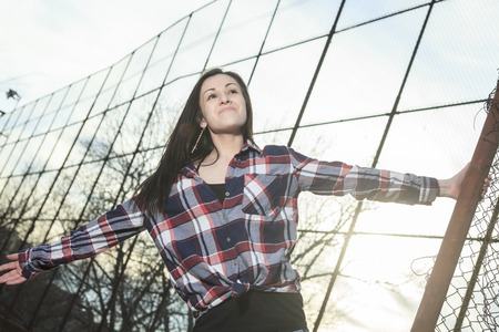 fense: a teen up holding a fense and smiling Stock Photo