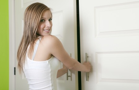 closet: A attractive young teen girl open closet