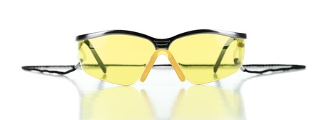tinted glasses: A Yellow safety glasses isolated on the white background
