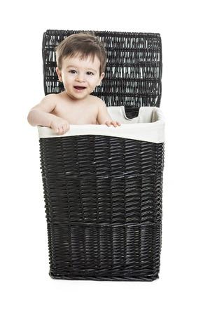 clothe: A Baby child on a clothe backet