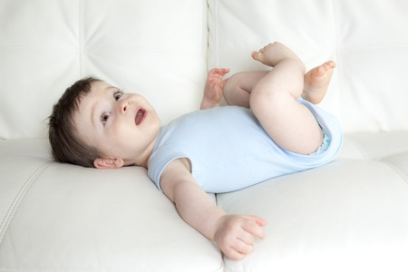 babyboy: A baby boy relaxing in sofa at home