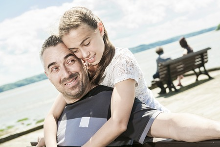 A Father with his daughter at sea getting good time