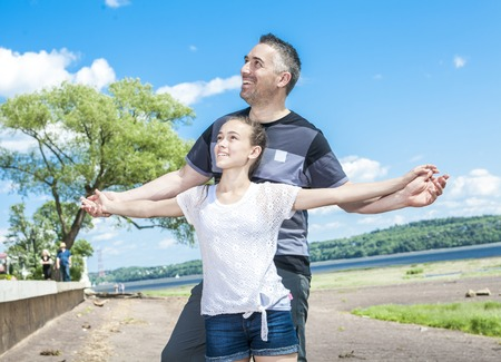 40 year old man: A Father and daughter having fun time outside