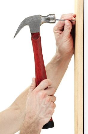 nailing: A Hammer nail hit  in front of a white background Stock Photo