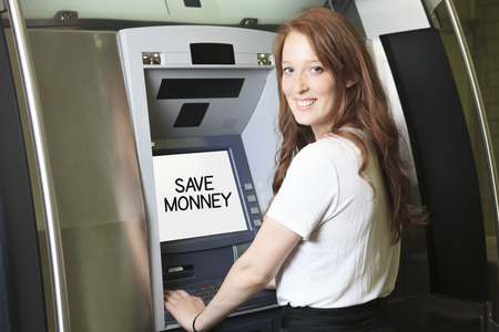 indebt: A student using a ATM machine at school